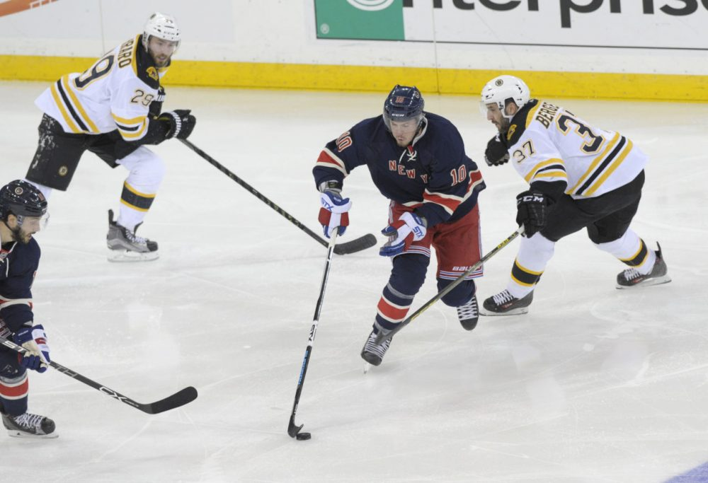 Rangers' J.T. Miller skates between Bruins' Patrice Bergeron, right, and Landon Ferraro, left, during the third period of a game Monday, at Madison Square Garden. (Bill Kostroun/AP)