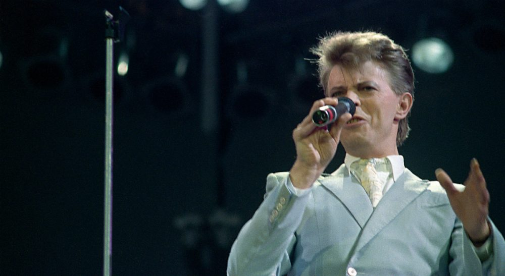 "Whether you loved him, hated him, or as many people did -- both -- David Bowie leaves an invaluable legacy of artistic innovation. The innovative and iconic singer whose illustrious career lasted five decades with hits like ""Fame,"" ''Heroes"" and ""Let's Dance,"" died after a battle with cancer on Sunday, Jan. 10, 2016. He was 69. Bowie is pictured here performing at Wembley Stadium in London, England July 13, 1985. (AP)"