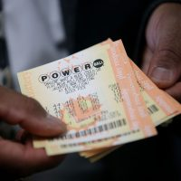 A customer holds Powerball tickets that he purchased at Kavanagh Liquors on January 12, 2015 in San Lorenzo, California. Dozens of people lined up outside of Kavanagh Liquors, a store that has had several multimillion-dollar winners, to purchase Powerball tickets in hopes of winning the estimated record-breaking $1.5 billion jackpot. (Justin Sullivan/Getty Images)