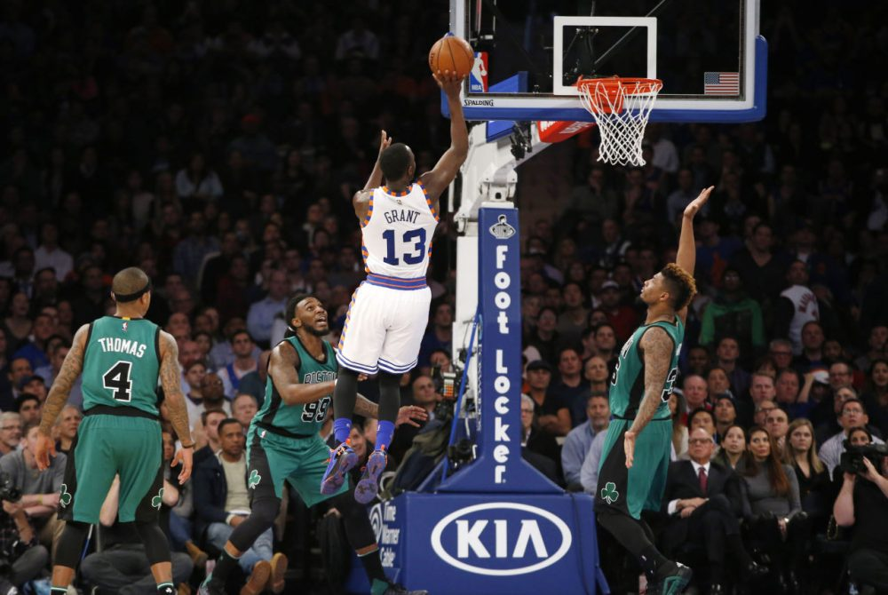 Knicks guard Jerian Grant shoots as Celtics guard Isaiah Thomas, forward Jae Crowder and guard Marcus Smart watch during a game at Madison Square Garden, Tuesday, Jan. 12, 2016.  (Kathy Willens/AP)