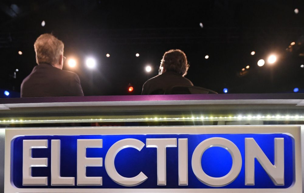 Dave Pregosin, right, lead stage manager, and Jeff Hark, left, director of production, sit in for moderators at the North Charleston Coliseum, Wednesday, Jan. 13, 2016, in North Charleston, S.C., in advance of Thursday's Fox Business Network Republican presidential debate. (Rainier Ehrhardt/AP)