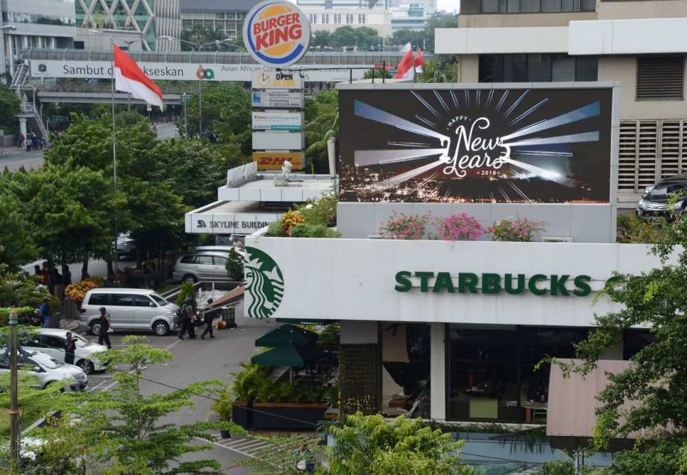 Indonesian police secure the area outside a damaged Starbucks coffee shop after a series of explosions hit central Jakarta on January 14, 2016. Gunfire and explosions in the Indonesian capital Jakarta killed at least four people on January 14 in what the country's president dubbed 'acts of terror', with fears that militants were still on the run. Starbucks announced in a statement that the company was closing all of its Jakarta branches 'until further notice' after one of its stores in the Indonesian capital was hit by apparent suicide attacks. (Romeo Gacad/AFP/Getty Images)