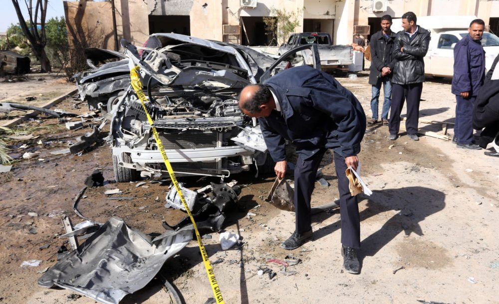 Libyan security forces inpect damaged cars at the site of a suicide truck bombing on a police school in Libya's coastal city of Zliten, some 170 kilometres (100 miles) east of the capital Tripoli, which killed at least 50 people on January 7, 2016, in the deadliest attack to hit the strife-torn country since its 2011 revolution. (Mahmud Turkia/AFP/Getty Images)