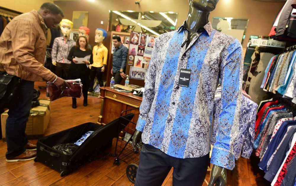 """A shirt known as """"Fantasy,"""" a replica of the shirt worn by Mexican drug-lord Joaquin 'El Chapo' Guzman is prominently displayed for sale at Barabas, a retail shop in the city's Fashion District in Los Angeles, California on January 13, 2016. No one would have called Mexican drug lord Joaquin """"El Chapo"""" Guzman a fashion icon when photos of his arrest last week showed the recaptured capo in a smeared, dirty undershirt. But one Los Angeles retailer is cashing in on an altogether more dapper depiction of the kingpin, in a newly iconic snapshot with Sean Penn. (Frederic J. Brown/AFP/Getty Images)"""