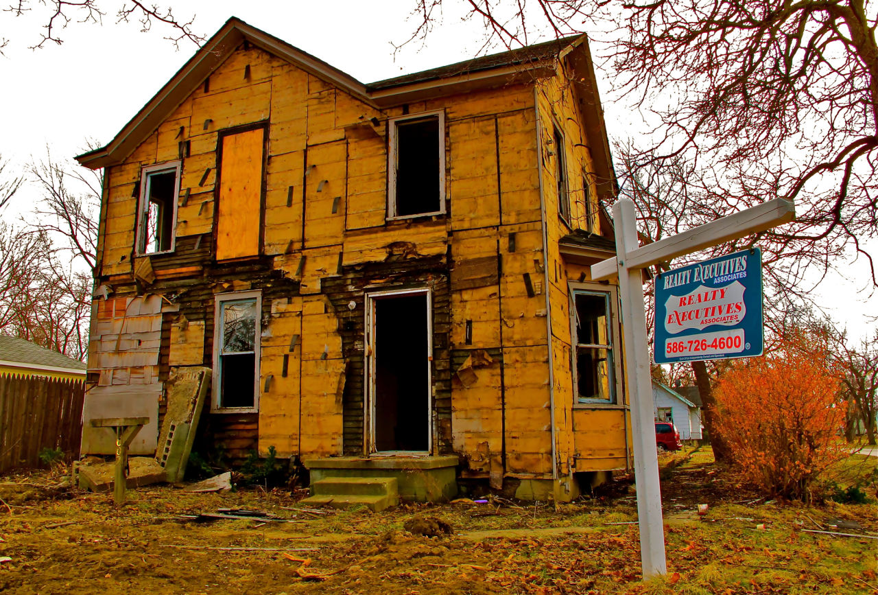 Throughout Flint, abandoned houses like this one are ravaged by thieves known as scrappers in search of any metal they can resell — doorknobs, radiators, aluminum siding, but especially copper wiring and plumbing. (Gordon Young)