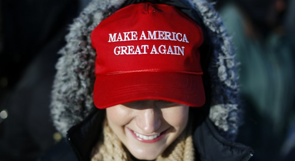 Picking apart Donald Trump's trademark slogan, which -- as it turns out -- was also used by Ronald Reagan at one point. In this photo, a Trump supporter waits in line to attend a rally featuring the Republican presidential candidate at the Surf Ballroom in Clear Lake, Iowa, Saturday, Jan. 9, 2016. (Patrick Semansky/ AP)
