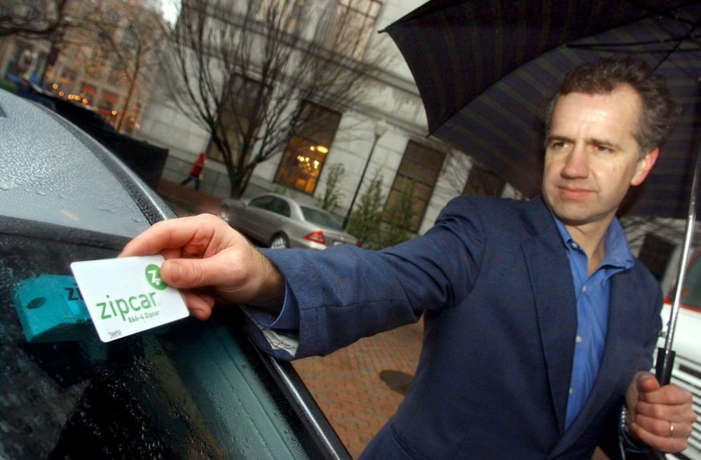"Clark Waterfall of Hopkinton unlocks his Zipcar in Boston. In ""Sharing Cities,"" Julian Agyeman argues we can move beyond just a sharing economy, to share more broadly in our communities. (Lisa Poole/AP)"