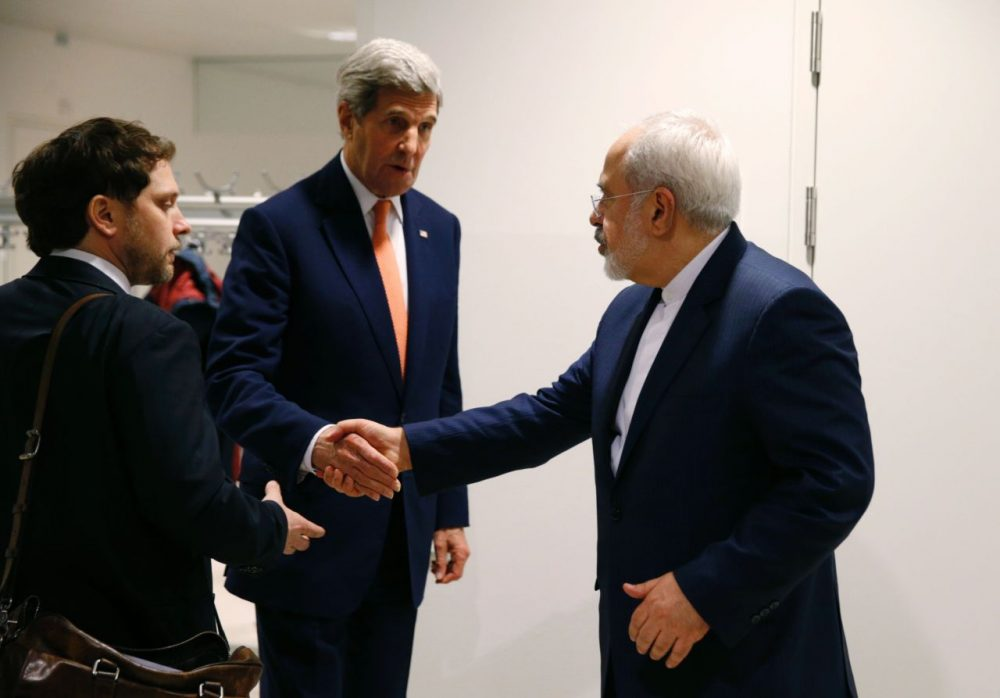 U.S. Secretary of State John Kerry (center) shakes hands with Iranian Foreign Minister Mohammad Javad Zarif (right) after the International Atomic Energy Agency (IAEA) verified that Iran has met all conditions under the nuclear deal during the E3/EU+3 and Iran talks in Vienna on January 16, 2016. The historic nuclear accord between Iran and major powers entered into force as the UN confirmed that Tehran has shrunk its atomic program and as painful sanctions were lifted on the Islamic republic. (Kevin Lamarque/AFP/Getty Images)