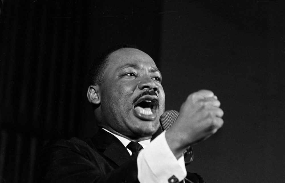 Dr. Martin Luther King Jr. shakes his fist during a speech in Selma, Ala., Feb. 12, 1965. (Horace Cort/AP)