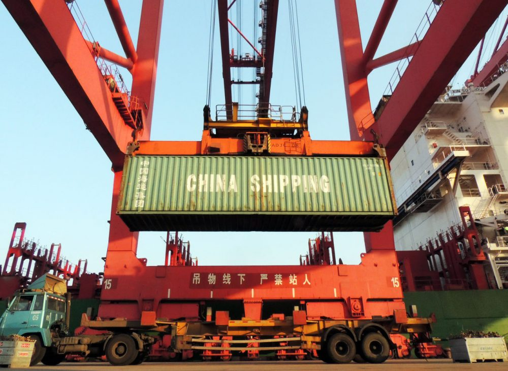 Containers are transported at a port in Lianyungang, eastern China's Jiangsu province on January 19, 2016. China's GDP grew at its slowest in a quarter of a century last year, creating pressure for more stimulus policies to ensure a soft landing for the economy that is a crucial driver of global growth. (STR/AFP/Getty Images)
