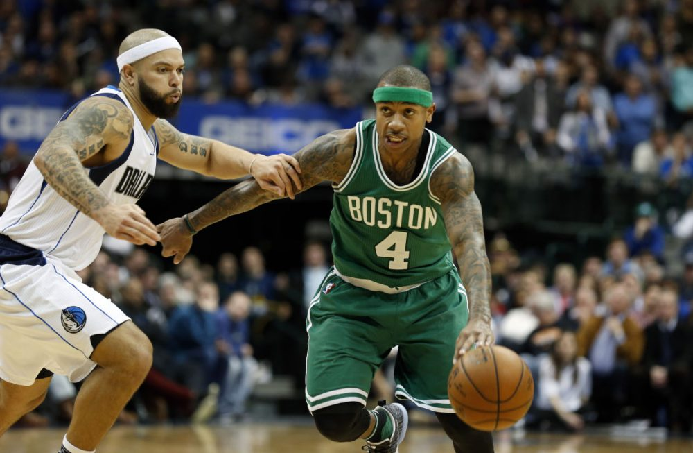 Dallas Mavericks guard Deron Williams defends Boston Celtics guard Isaiah Thomas during overtime of Monday's game in Dallas. (Sharon Ellman/AP)