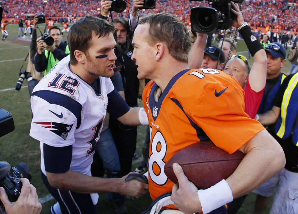 Peyton Manning and Tom Brady will go head-to-head Sunday for the 17th time of their illustrious careers.  (Photo by Kevin C. Cox/Getty Images)