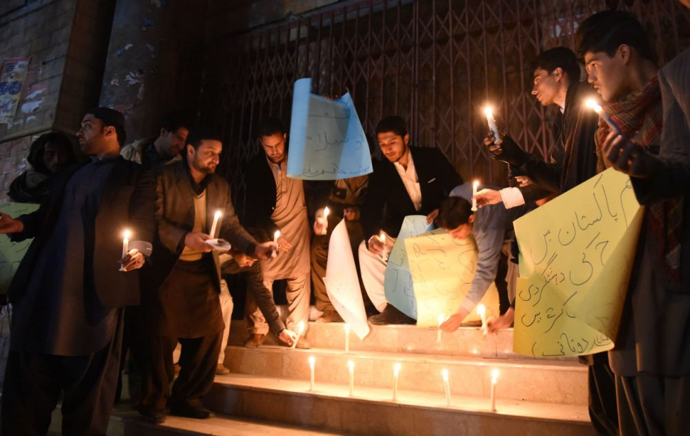 Pakistani students lights candles for victims at Bacha Khan university following an attack, in Quetta on January 20, 2016. At least 21 people died in a Taliban assault on a university in Pakistan, where witnesses reported two large explosions as security forces moved in under dense fog to  halt the bloodshed. (BANARAS KHAN/AFP/Getty Images)