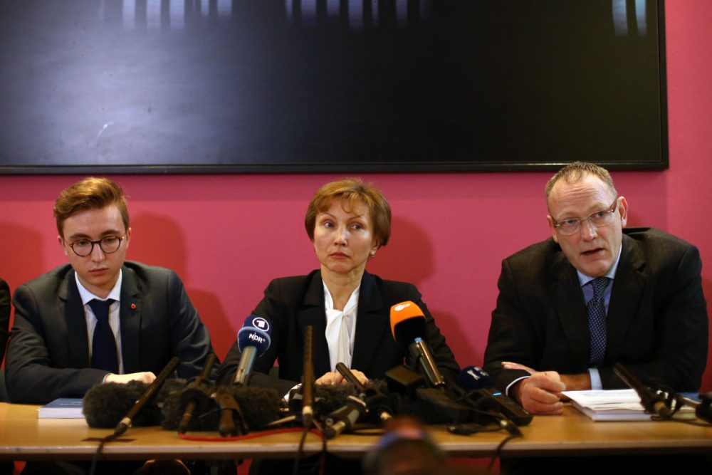 Marina Litvinenko (center) and her son Anatoly (left) listen as their lawyer, Ben Emmerson speaks during a press conference after receiving the results of the inquiry into the death of Marina's husband Alexander Litvinenko, on January 21, 2016 in London, England. Former KGB officer Alexander Litvinenko was poisoned in 2006 with radioactive polonium-210 in the United Kingdom, after fleeing Russia and criticizing president Vladimir Putin. (Carl Court/Getty Images)