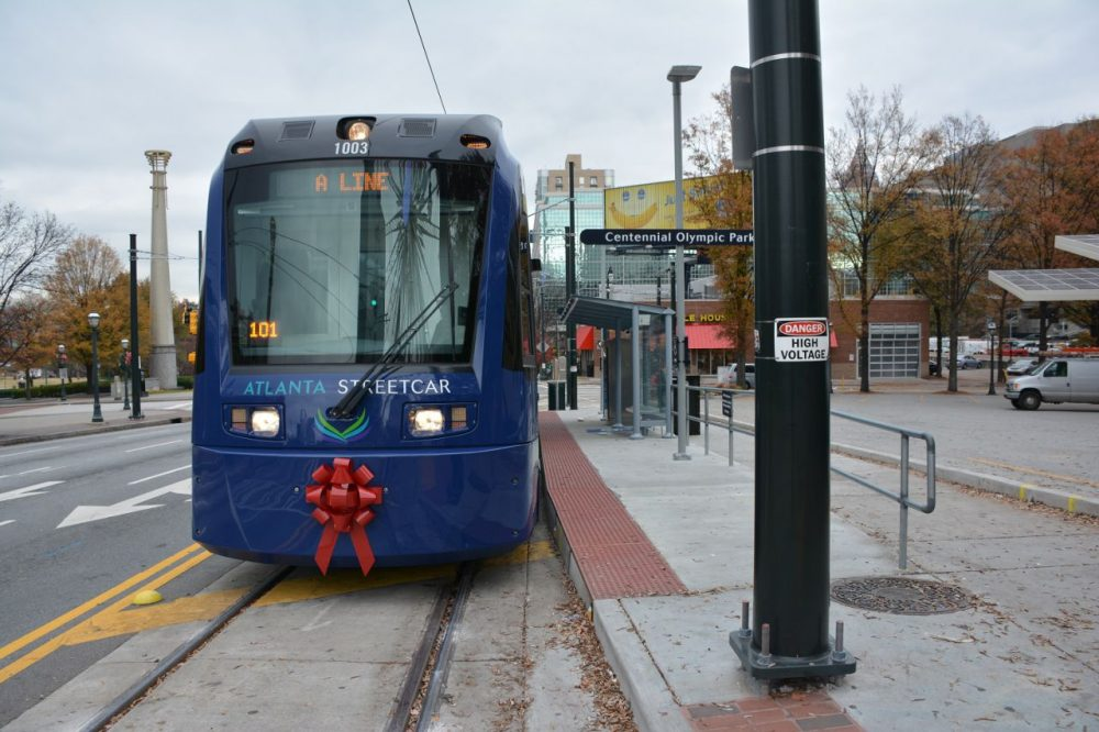 The Atlanta Streetcar waits at the Centennial Olympic Park stop for passengers to board. (Sam Whitehead/GPB News)