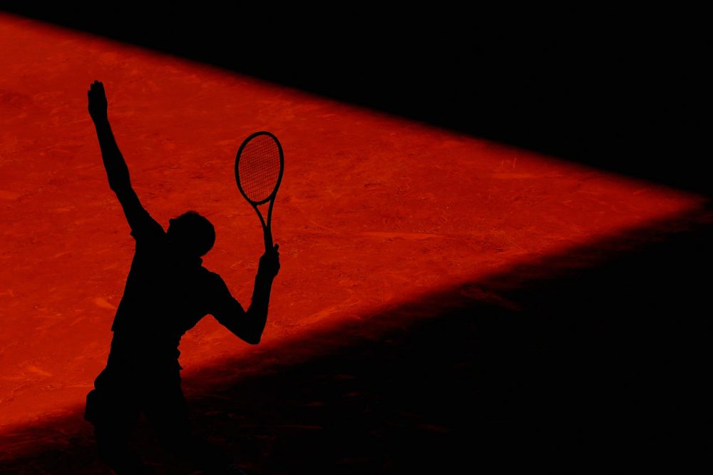 A silhouette of a tennis player serving. (Julian Finney/Getty Images)