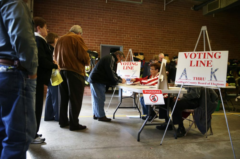 Voters check in to cast their ballots at a fire station that serves as a polling place November 4, 2014 in Climax, North Carolina. (Alex Wong/Getty Images)