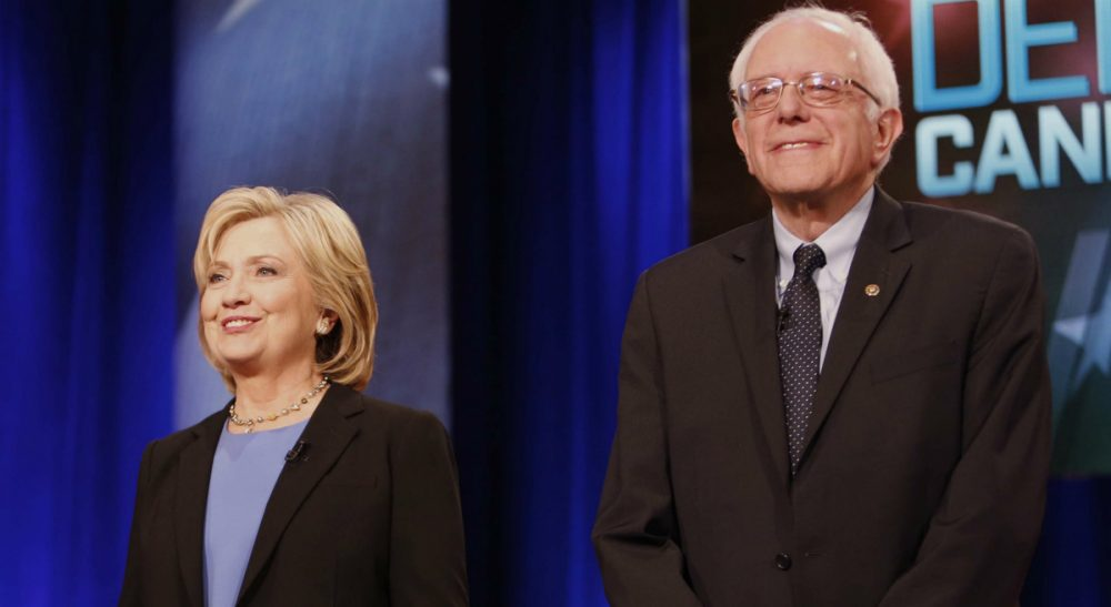 Steve Almond, a Bernie Sanders supporter, pens an open letter to his wife, who supports Hillary Clinton. In this photo, Clinton and Sanders stand together before the start of the NBC, YouTube Democratic presidential debate at the Gaillard Center, Sunday, Jan. 17, 2016, in Charleston, S.C. (Mic Smith/ AP)