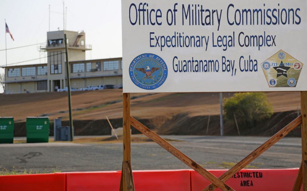 This June 17, 2013, photo shows a sign outside the Courthouse One Expeditionary Legal Complex at Naval Station Guantanamo Bay, Cuba. U.S. prosecutors are asking a military judge to reconsider his decision to try one of the men accused of plotting the Sept. 11 attack apart from the other four. Prosecutors have asked Army Col. James Pohl to hear arguments on their emergency motion involving Binalshibh first thing Monday, Aug. 11, 2014, at a pretrial hearing at the Guantanamo Bay naval base in Cuba. (Bill Gorman/AP)