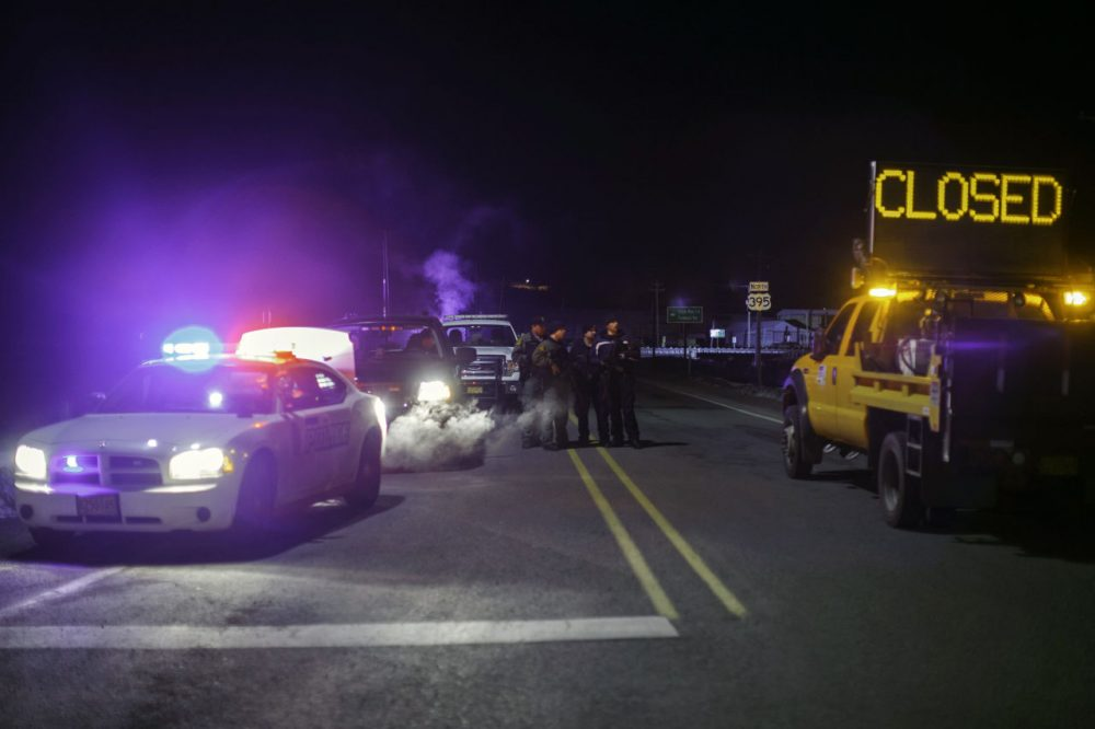 Law enforcement personnel monitor an intersection of closed Highway 395 in Burns, Oregon on January 26, 2016, during a standoff pitting an anti-government militia against the US authorities. One person died in an armed clash with police as they arrested the leaders of a group laying siege to an American wildlife refuge, the FBI said January 26. (ROB KERR/AFP/Getty Images)