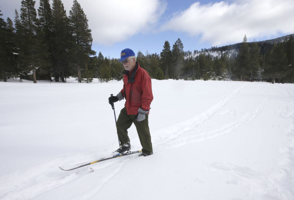 Frank Gehrke, chief of the California Cooperative Snow Surveys Program for the Department of Water Resources, leaves the snow covered meadow where he performed the first manual snow survey of the season at Phillips Station near Echo Summit, Calif., Wednesday, Dec. 30, 2015. The survey showed the snowpack to be nearly 5 feet deep, with a water content of 16.3 inches, which is 136 percent of normal for this site at this time of year. Rich Pedroncelli/AP)