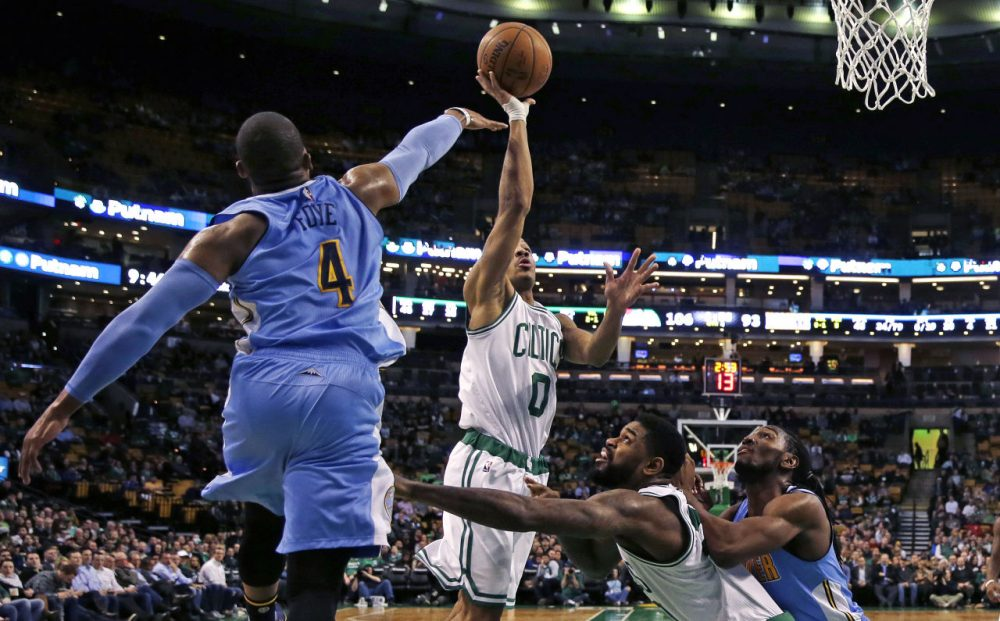 Celtics guard Avery Bradley drives to the basket against Nuggets guard Randy Foye (4). (Charles Krupa/AP)