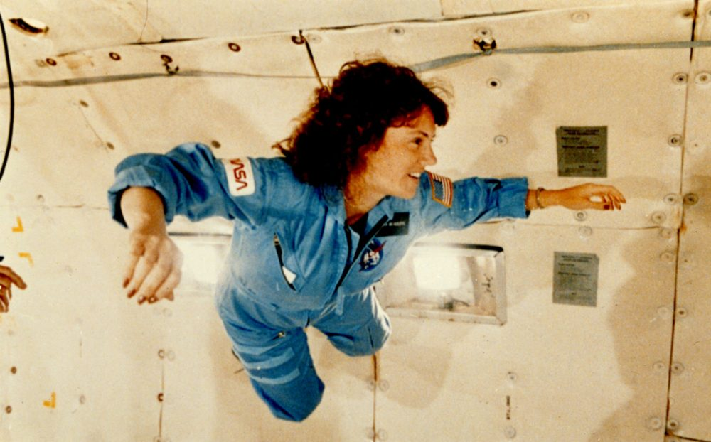 "Christa McAuliffe experiences weightlessness during pre-flight training exercises known as a ""vomit comet."" (Keith Meyers of the New York Times via Wikimedia Commons)"