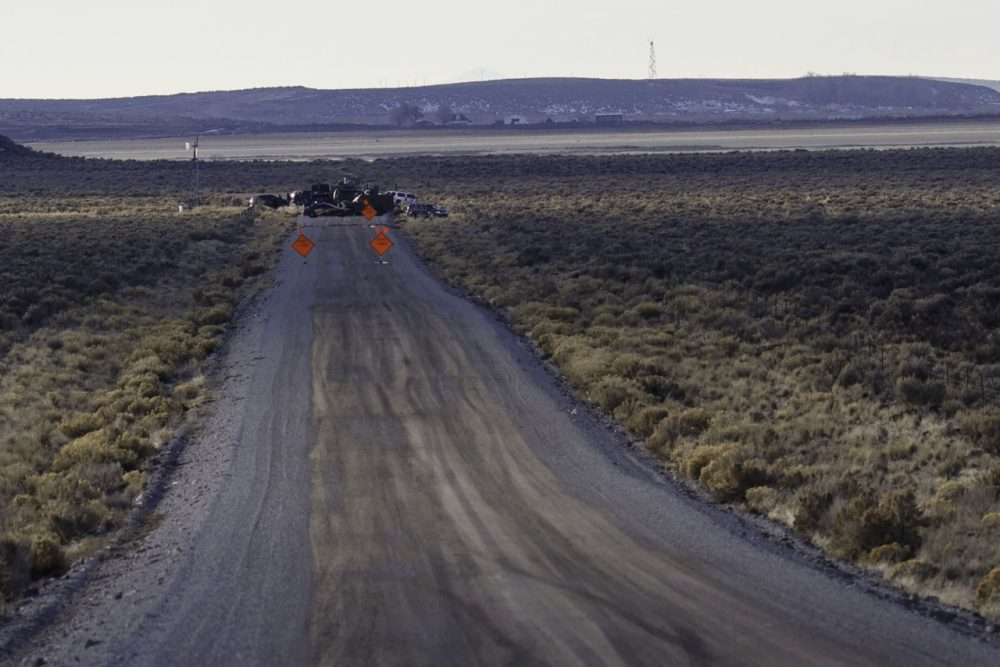 Law enforcement agencies operate a checkpoint on a road as a containment strategy surrounding the Malheur Wildlife Refuge January 27, 2016 near Burns, Oregon. Although leaders of a group that illegally occupied the federal buildings were arrested, many armed occupants still on site have said that they intend to stay despite repeated requests to leave. The iconic wildlife tower of the buildings is visible in the upper left of this photograph. (Rob Kerr/AFP/Getty Images)