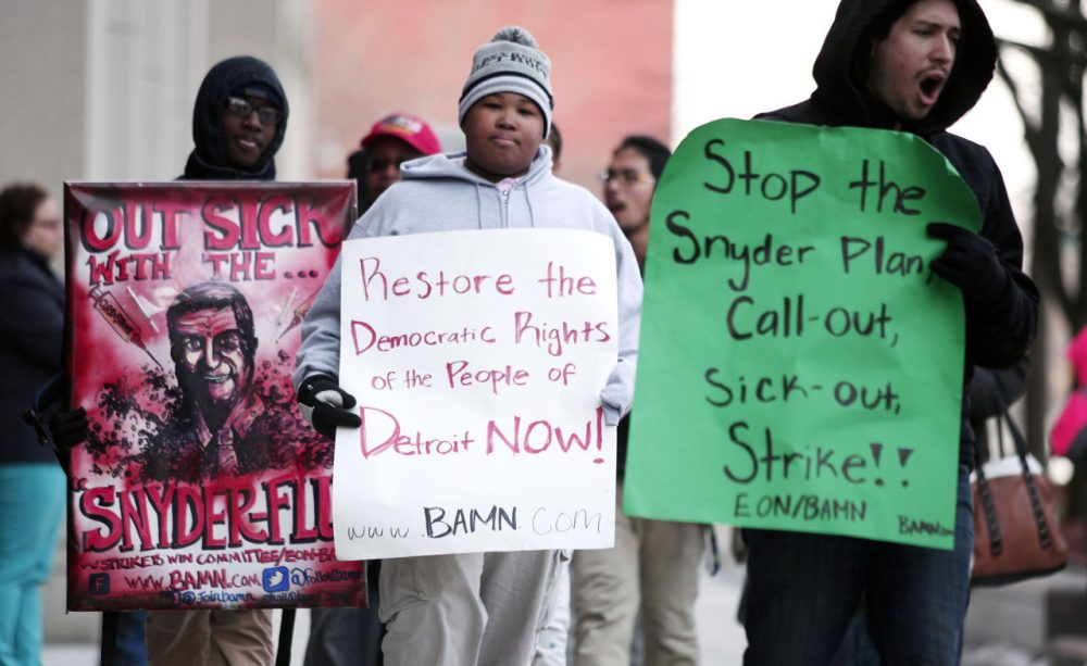 "Demonstrators protest a hearing at the State of Michigan Building January 25, 2016 in Detroit, Michigan. The hearing will decide whether or not to order an end to the ""sick-out"" by Detroit Public School teachers and organizers. One sick-out last week led to the closing of 88 Detroit schools. (Bill Pugliano/Getty Images)"