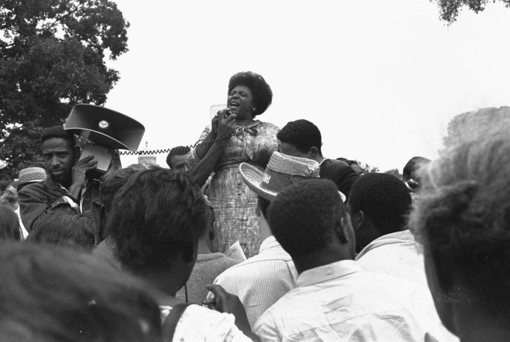 Mrs. Fannie Lou Hamer of Ruleville, Mississippi, speaks to Mississippi Freedom Democratic Party sympathizers outside the Capitol in Washington in 1965. (William J. Smith/AP)