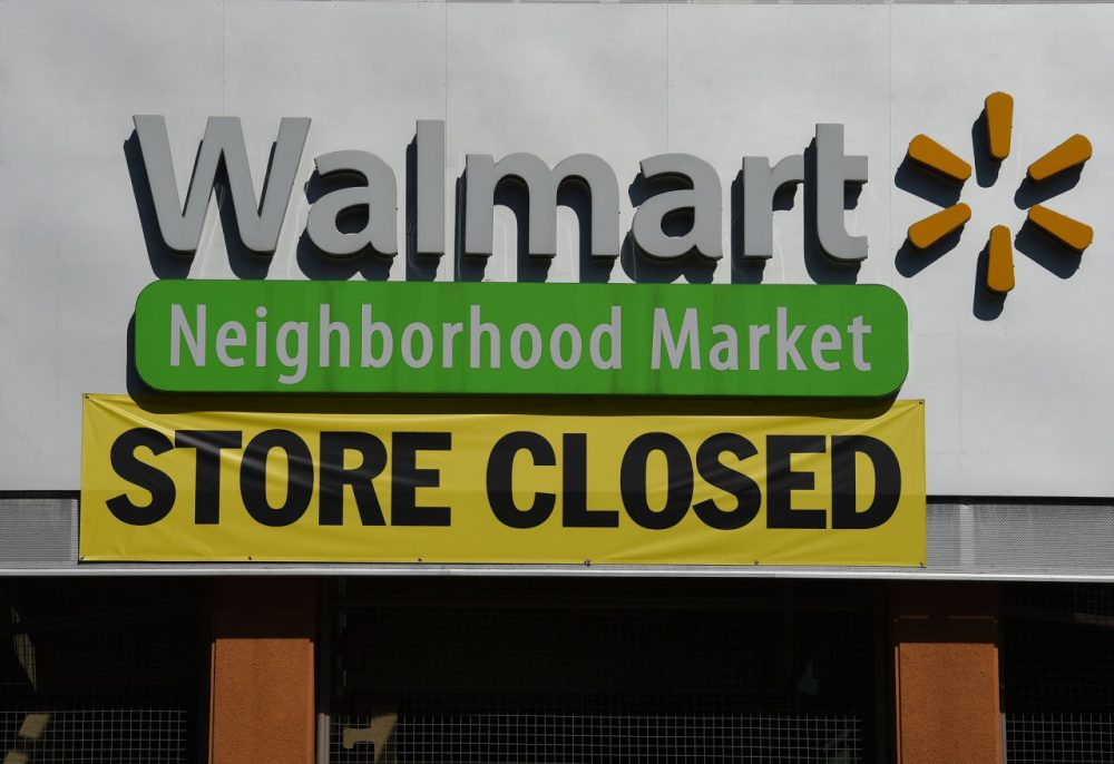 A closed sign is seen on a Walmart store in Chinatown that is part of the closure of 154 store locations across the U.S., in Los Angeles, California on January 28, 2016. The US retailing giant Walmart recently announced it is shuttering 269 stores inside and outside the U.S., with Latin America the hardest-hit foreign market.    (Mark Ralston/AFP/Getty Images)