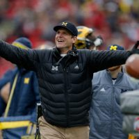 Michigan football Jim Harbaugh is known for the enthusiastic way in which he approaches the game. (Photo by Gregory Shamus/Getty Images)