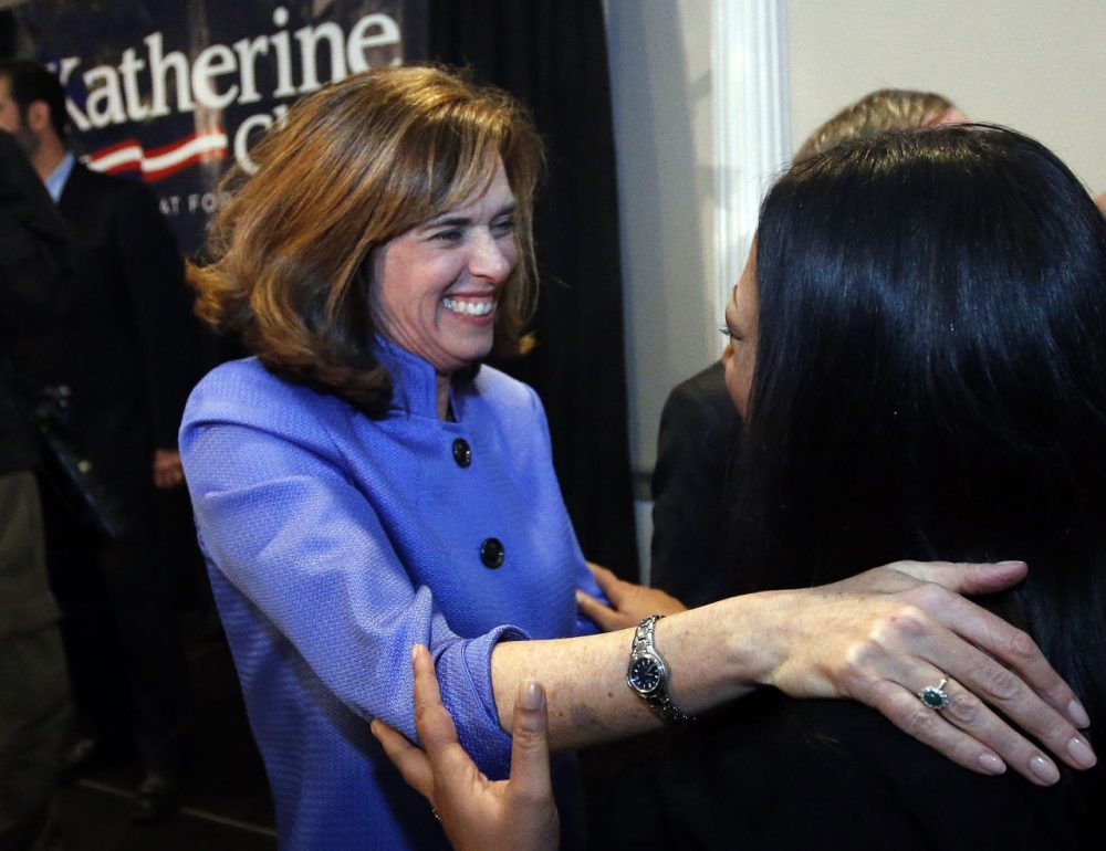 Democrat Katherine Clark greets a supporter at her election night party in Stoneham, Mass., Tuesday, Dec. 10, 2013, where she claimed victory in a special election for the vacated seat in Massachusetts' 5th Congressional District. The seat was left vacant by Edward Markey, who resigned after winning a special election to fill John Kerry's U.S. Senate seat after he had stepped down to become secretary of state. Clark defeated Republican Frank Addivinola, a Boston attorney. (AP Photo/Elise Amendola)