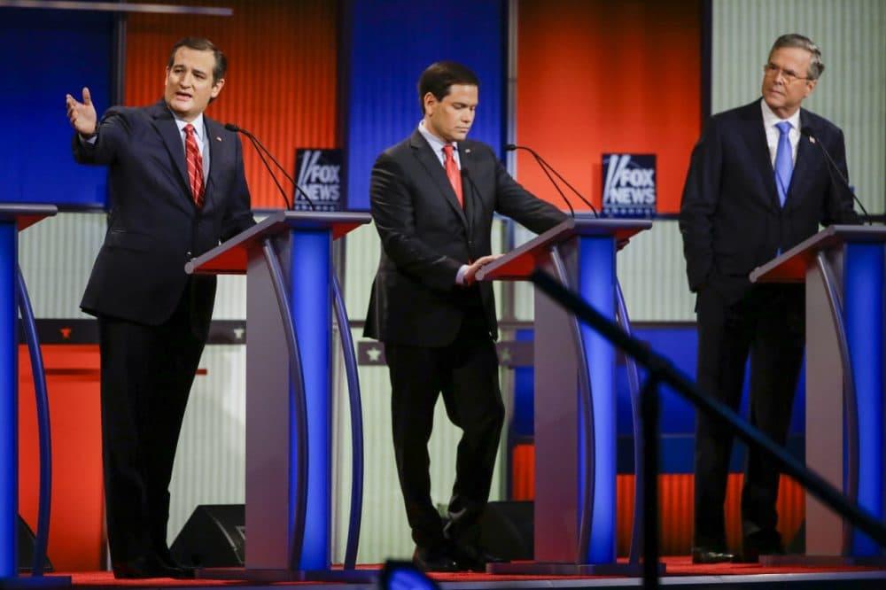 Republican presidential candidate Sen. Ted Cruz, Sen. Marco Rubio and former Florida Gov. Jeb Bush at Thursday night's Republican presidential primary debate in Des Moines, Iowa. (Charlie Neibergall/AP)