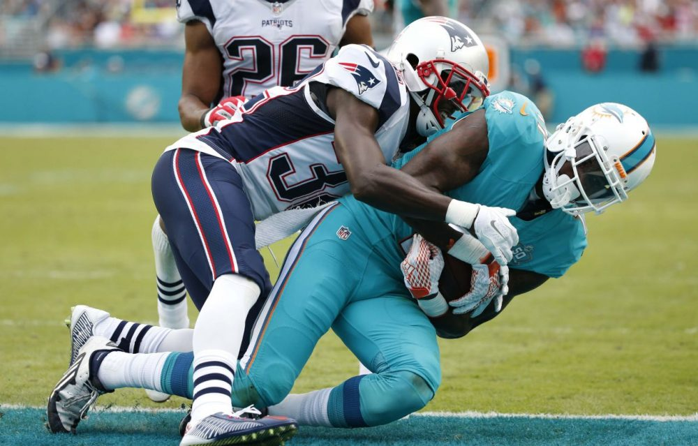 Miami Dolphins wide receiver DeVante Parker (11) scores a touchdown as Patriots free safety Devin McCourty (32) defends during Sunday's game in Miami Gardens, Florida. (Wilfredo Lee/AP)