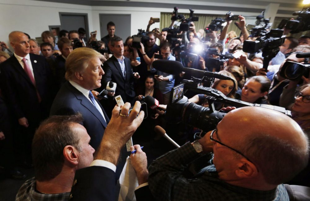 Republican presidential candidate Donald Trump talks with reporters at a campaign event in October 2015. (Jim Cole/AP)