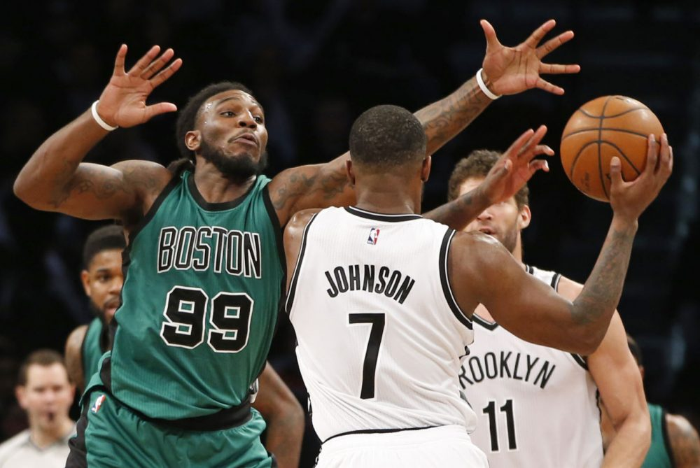 Celtics forward Jae Crowder (99) defends Brooklyn Nets forward Joe Johnson (7) who looks to pass as Brooklyn Nets center Brook Lopez (11) waits on the floor, right, in a game Monday in New York. (Kathy Willens/AP)