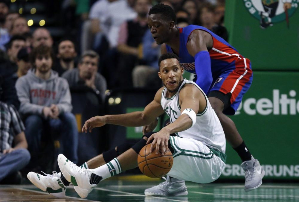 Boston Celtics' Evan Turner, bottom, in action against Detroit Pistons' Reggie Jackson during a game in Boston Wednesday. (Michael Dwyer/AP)