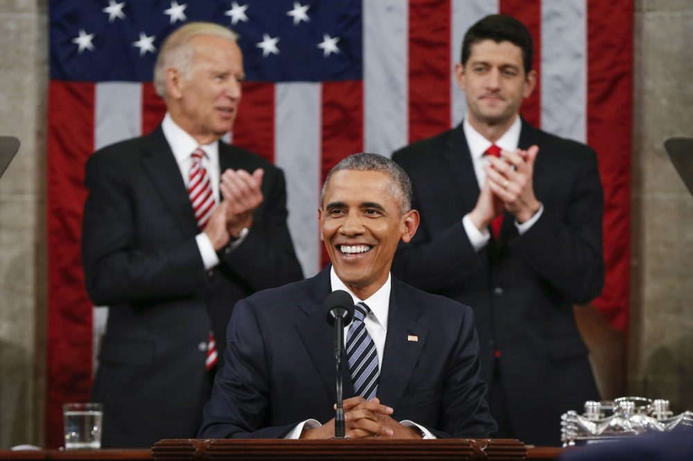 Vice President Joe Biden, left, and House Speaker Paul Ryan applaud President Obama during the State of the Union address Tuesday night. (Evan Vucci/AP)