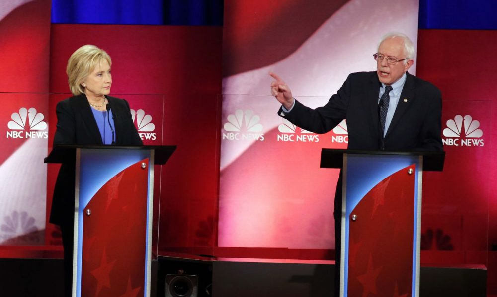 Bernie Sanders gestures toward Hillary Clinton during the Democratic presidential debate Sunday evening in Charleston, S.C. (Mic Smith/AP)