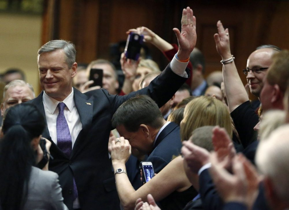 Gov. Charlie Baker arrives in the House chamber to deliver his State of the Commonwealth address Thursday evening. (Michael Dwyer/AP)