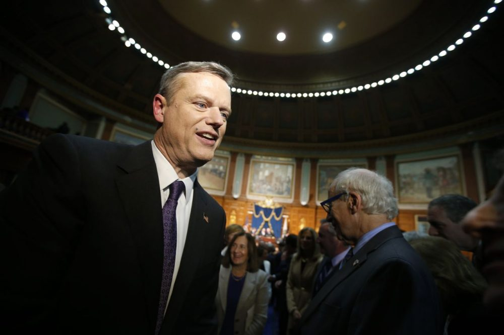 Gov. Baker's budget proposal reflects the ongoing reality that fixed costs required for MassHealth, pensions, debt service and other expenses continue to consume large chunks of new revenue. Here, Gov. Baker leaves the House chamber after delivering his State of the Commonwealth address on Jan. 21. (Michael Dwyer/AP)