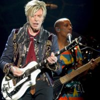 Rock vocalist David Bowie, left, performs at the Fleet Center in Boston, on March 30, 2004. (Robert E. Klein/AP)