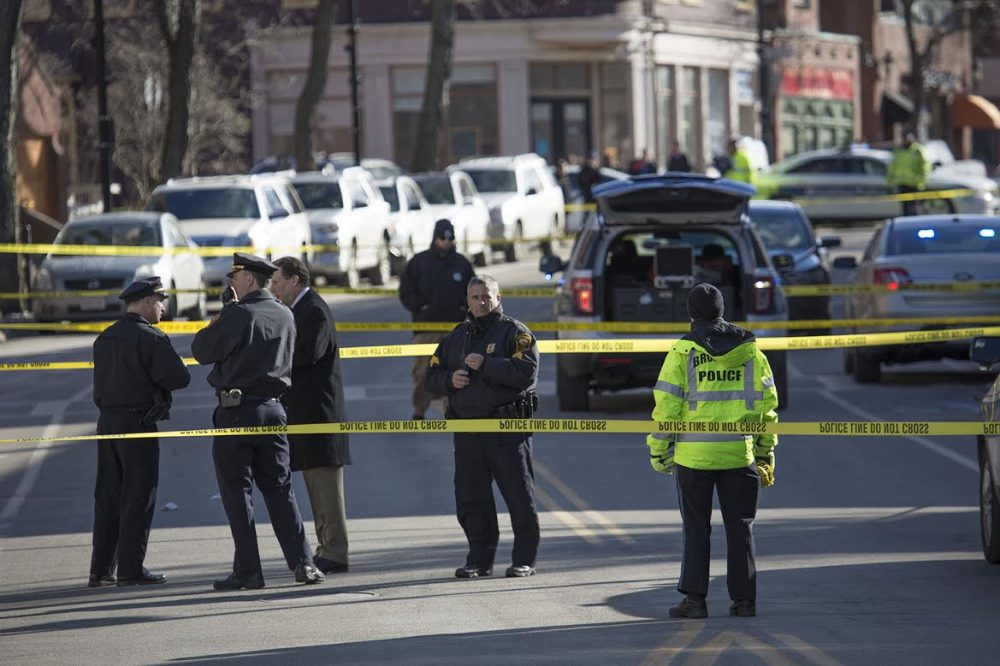 Brookline Police block off Harvard Street, after the report of a shooting midday Wednesday. (Jesse Costa/WBUR)