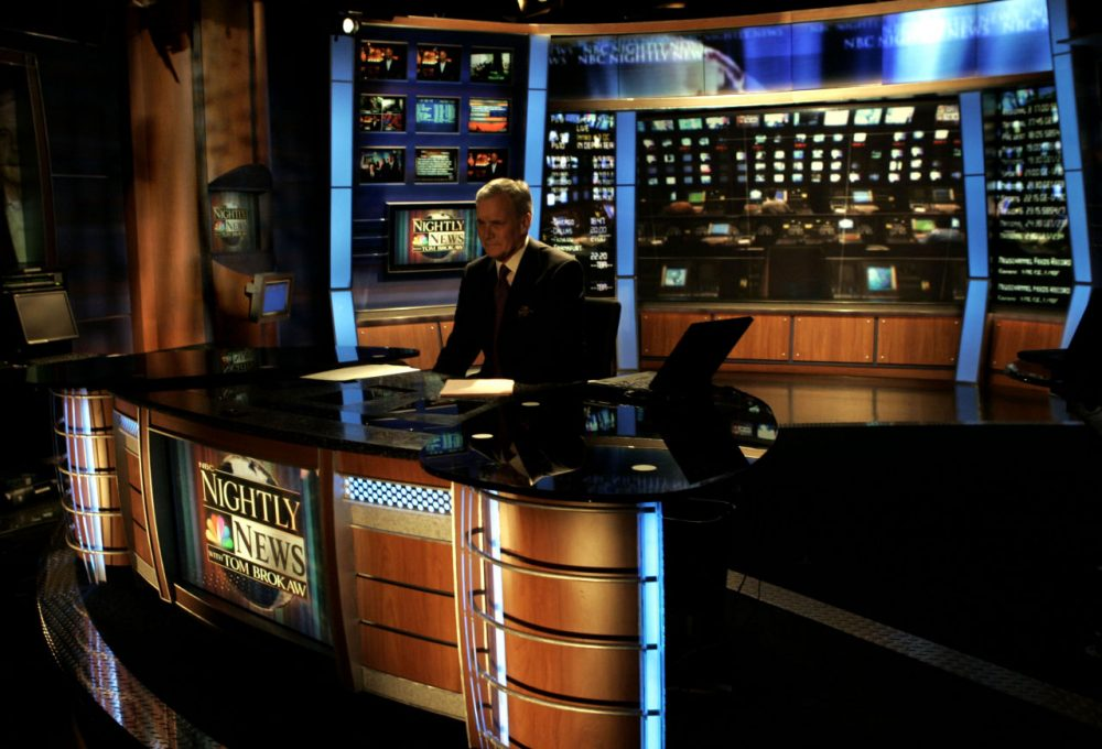 NBC announced it will end its affiliation with Channel 7 news in Boston. Nightly News anchor Tom Brokaw sits at his desk as the lights dim at the close of his last broadcast, in New York, Wednesday Dec. 1, 2004. . (AP Photo/Richard Drew)