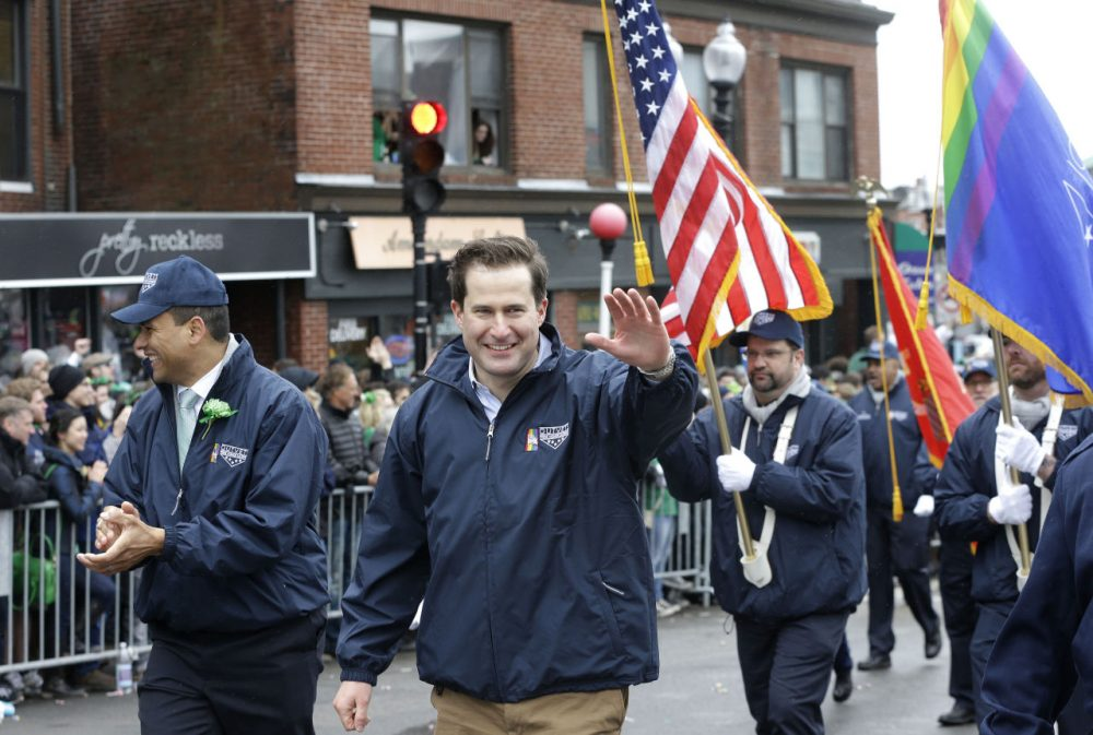 U.S. Rep. Seth Moulton, D-Mass., center, waves while marching with members of OutVets, a group of gay military veterans, as they participate in the St. Patrick's Day parade, Sunday, March 15, 2015, in Boston's South Boston neighborhood. Until now, gay rights groups have been barred by the South Boston Allied War Veterans Council from marching in the parade, which draws as many as a million spectators each year. (AP Photo/Steven Senne)