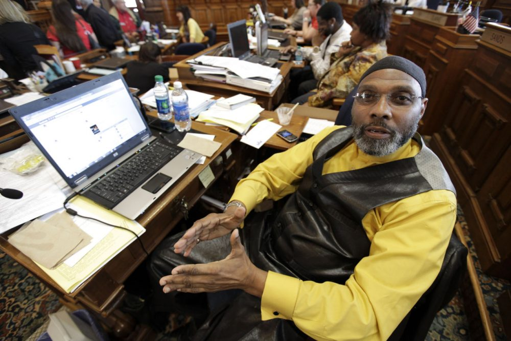 Rep. Ako Abdul-Samad, D-Des Moines, sits at his desk in the Iowa House Wednesday, April 4, 2012, at the Statehouse in Des Moines, Iowa. (Charlie Neibergall/AP)