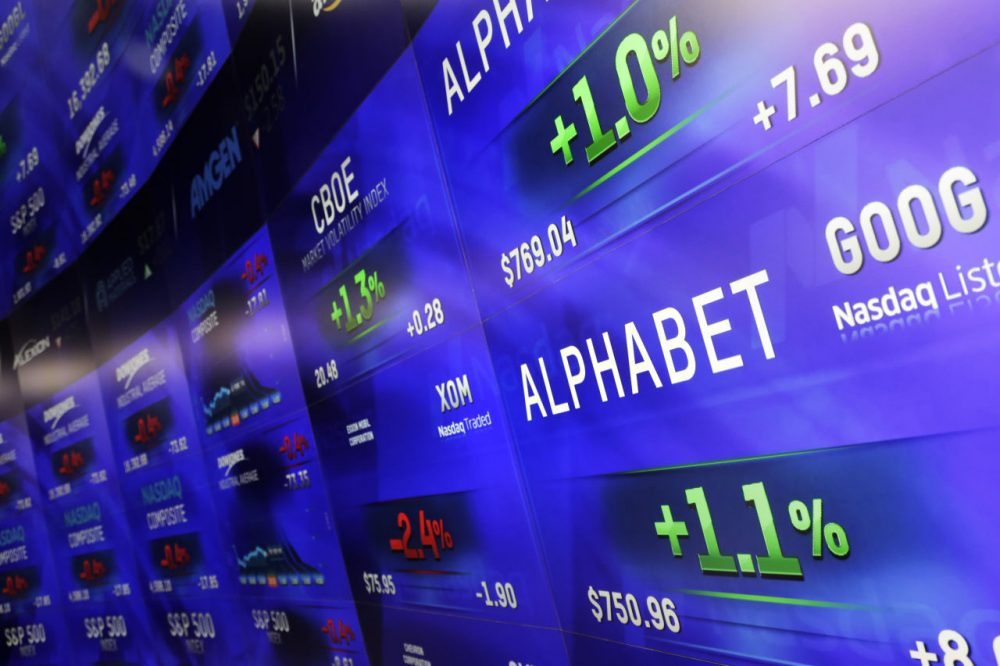 Electronic screens post prices of Alphabet stock, Monday, Feb. 1, 2016, at the Nasdaq MarketSite in New York. Alphabet, the parent company of Google, reports quarterly earnings Monday. (Mark Lennihan/AP)