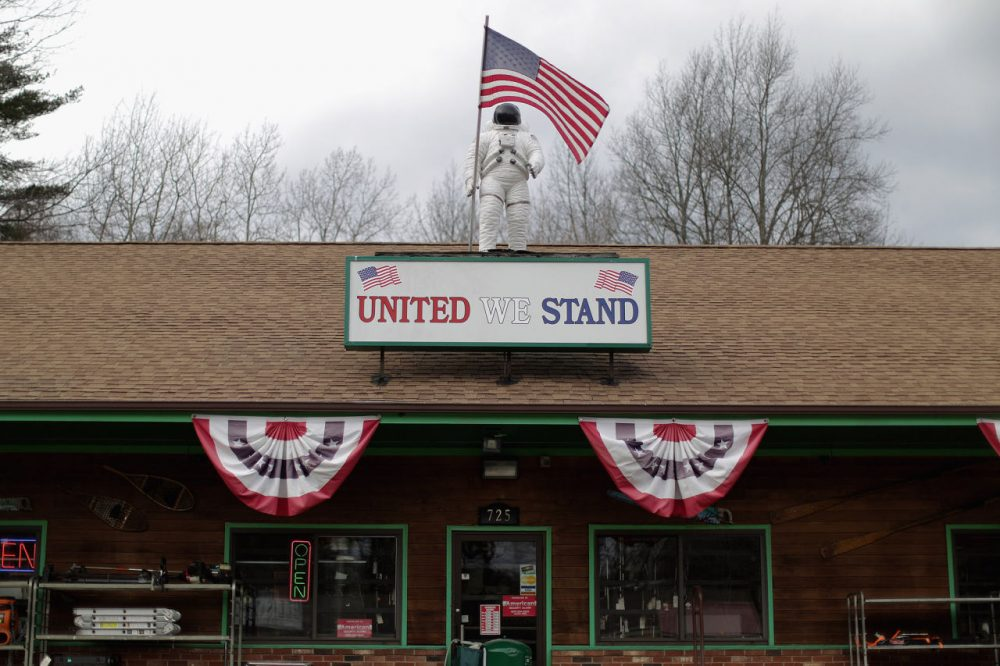 """The statue of an astronaut stands on the roof of the Quick Cash Trading Center Feburary 1, 2015 in Rochester, New Hampshire. With the completion of the Iowa caucuses, attention is quickly turning to the Granite State for the New Hampshire """"First In The Nation"""" presidential primary on Feburary 9. United States astronauts Alan Shepard and Christa McAuliffe are natives of New Hampshire.  (Chip Somodevilla/Getty Images)"""