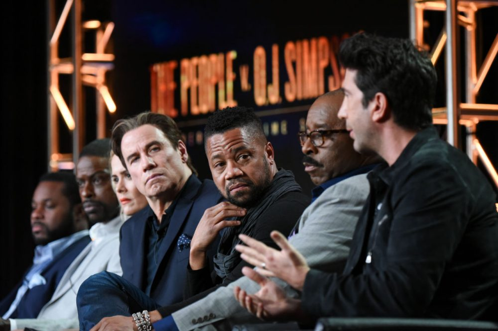 """From left: Actors Malcolm-Jamal Warner, Sterling K. Brown, Sarah Paulson, John Travolta, Cuba Gooding Jr., Courtney B. Vance and David Schwinner participate in """"The People v. O.J. Simpson"""" panel at the FX Networks Winter TCA on Saturday, Jan. 16, 2016, in Pasadena, Calif. (Richard Shotwell/Invision/AP)"""
